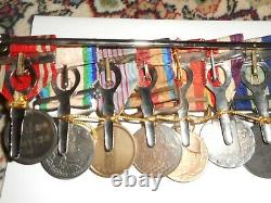Japanese Imperial medal bar 9 place. Rising sun 5th class etc